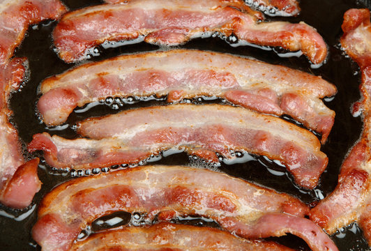 Bacon Strips Cooking