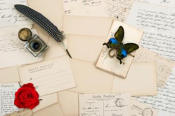 old letters, vintage postcards, rose flower, butterfly