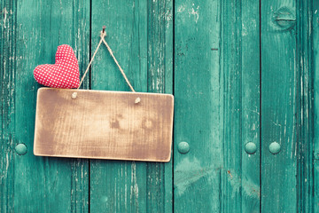 Valentine heart and signboard on vintage planks background