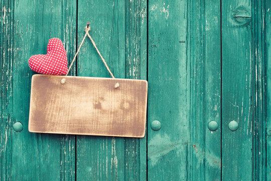 Valentine heart and signboard on vintage planks background