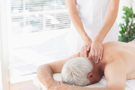 Senior man getting back massage