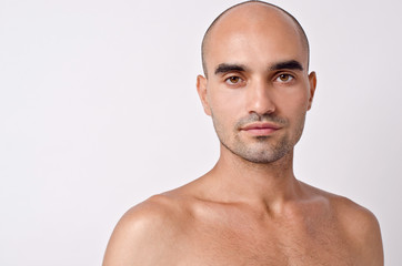 Bald Caucasian handsome man with topless shoulders. Wall mural