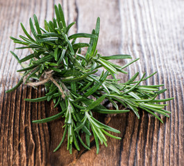 Fresh Rosemary on wood