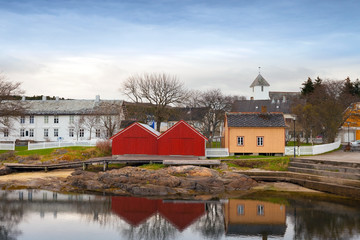 Colorful wooden houses in small Norwegian fishing village