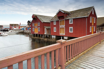 Red wooden houses in small Norwegian fishing village