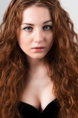Beautiful young woman with red hairs
