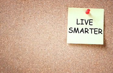live smarter concept. memo note pinned to corkboard