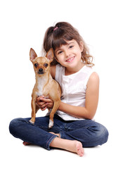 Little girl sitting on the floor with her chihuahua dog