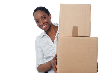 Young girl with cardboard boxes in hand