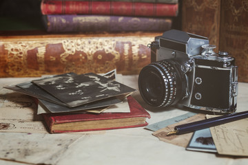 retro camera, old photos, letters and books with pen composition
