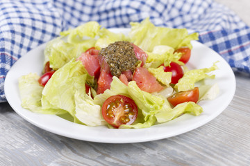 Salad with a salmon and cherry tomatoes