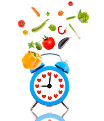 Diet concept, alarm clock ringing,hearts and fruits
