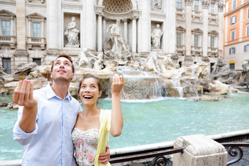 Aufkleber - Travel couple trowing coin at Trevi Fountain, Rome