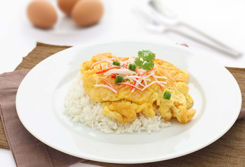 fried omelet topped on rice