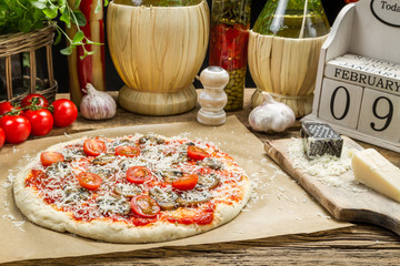 Preparing homemade pizza with fresh ingredients