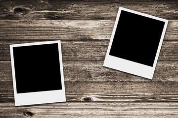 two Polaroid retro frames on wood texture