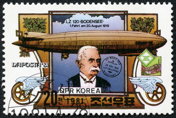 stamp shows portrait of Ferdinand von Zeppelin and dirigible