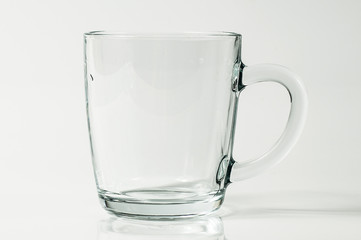 An isolated picture of a transparent glass mug