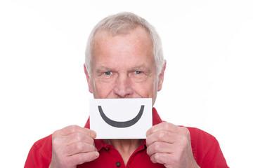 Senior man with smiley symbol