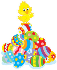 Easter Chick on top of a pile of painted eggs