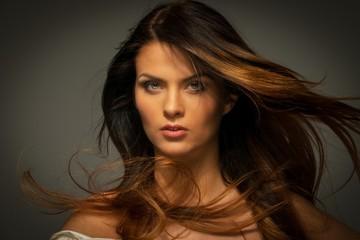 Seductive brunette woman with long hair