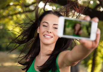 Young beautiful woman shooting self portrait