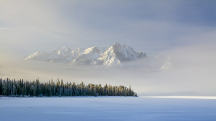 Idaho mountain lake with snow and fog in winter
