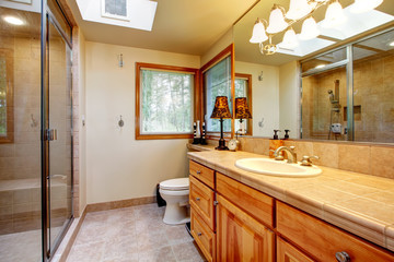 Warm cozy bathroom with windows
