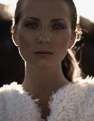 Portrait of beautiful fashion model at sunset