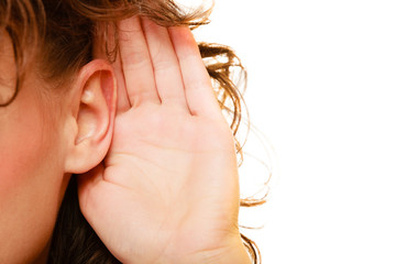 Part of head woman with hand to ear listening