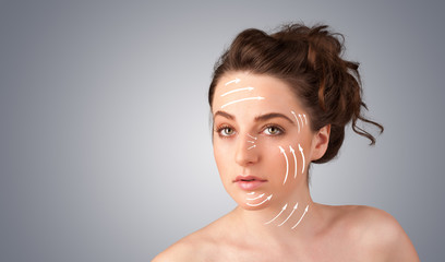 Beautiful girl with facial arrows on her skin