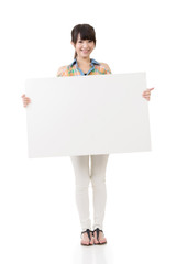 Asian woman holding blank gray board