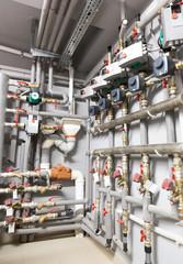 Boiler room vertical shot. A lot of pipes.