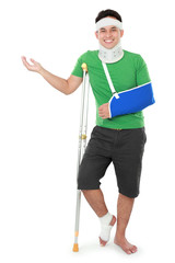 male with broken arm and crutch presenting