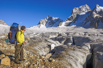 Hiker with a backpack on a glacier