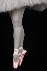 Ballet dancer standing on toes while dancing artistic converion