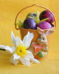 Easter bunny , eggs and flowers - yellow holiday background