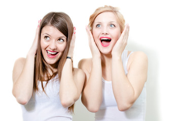 Two beautiful women friends closeup face portrait