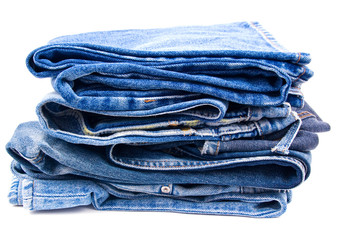 Pack of worn blue jeans isolated on white background