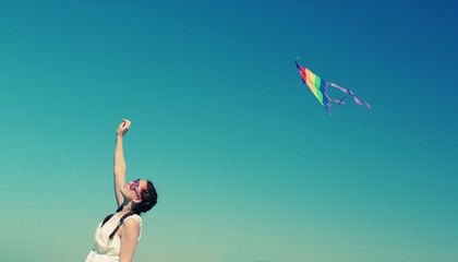 beautiful model holding kite and posing at the seaside