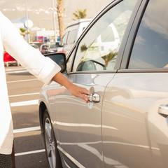 woman opens car door
