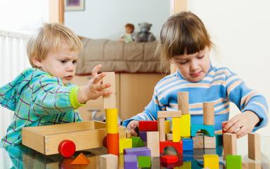 children  with wooden blocks