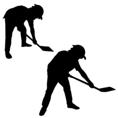 Silhouette of man with a spade