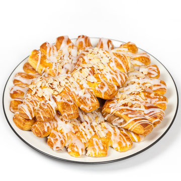 Bear claw pastry with sliced almonds and sugar