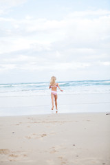 Young girl running at beach