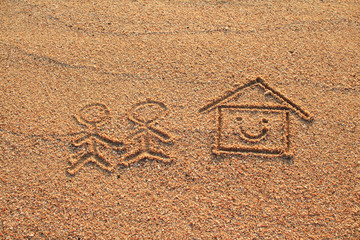 Happy lover and house with smile icon drawn on beach sand