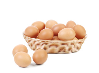 Brown eggs in the basket.