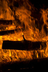 firewood burned in a bonfire closeup
