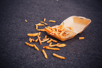 Box of chips on the ground