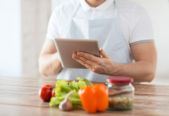 closeup of man reading recipe from tablet pc